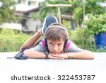 young caucasian boy listening... | Shutterstock . vector #322453787