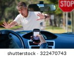 Small photo of An irresponsible texting driver is about to run over a pedestrian at an intersection which shows how dangerous texting and driving is. Stop the text and stop the wrecks.
