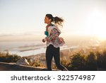 outdoor shot of a young woman... | Shutterstock . vector #322574987