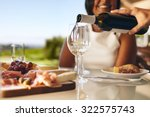hands of a man pouring white... | Shutterstock . vector #322575743