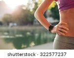 sportswoman wearing smartwatch... | Shutterstock . vector #322577237
