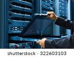 man fix server network in data...   Shutterstock . vector #322603103