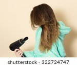 female dries hair with... | Shutterstock . vector #322724747