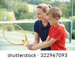 female tennis coach giving... | Shutterstock . vector #322967093
