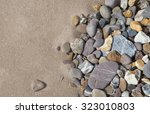 Pebbles On Beach Background