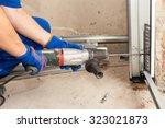 garage doors installation.... | Shutterstock . vector #323021873