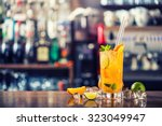 fresh cocktail with orange ... | Shutterstock . vector #323049947
