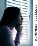 sad girl at the window | Shutterstock . vector #323122283