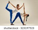 sporty yogi sisters doing... | Shutterstock . vector #323197523