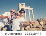 positive young family take a... | Shutterstock . vector #323210447