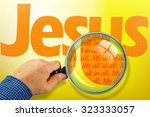 Small photo of The name JESUS observed with magnifying glass shows My All in All. Religious concept image