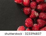 raspberries arranged off centre ... | Shutterstock . vector #323396837