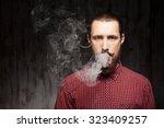 handsome bearded man is... | Shutterstock . vector #323409257