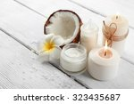 spa coconut products on light... | Shutterstock . vector #323435687
