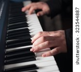 piano playing  close up on... | Shutterstock . vector #323544887
