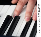 piano playing  close up on... | Shutterstock . vector #323544893