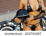 sexy motorcycle biker girl... | Shutterstock . vector #323731007