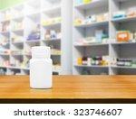blank white medicine bottle on... | Shutterstock . vector #323746607