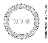 hand drawn round frame ... | Shutterstock .eps vector #323749283