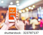 hand holding mobile with order... | Shutterstock . vector #323787137