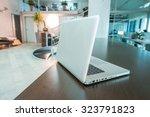 modern laptop on a modern... | Shutterstock . vector #323791823