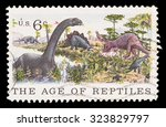 Small photo of UNITED STATES OF AMERICA - CIRCA 1970: A postage stamp printed in United States shows a several dinosaurs and the text the age of reptiles. Centenary of American Natural History Museum, circa 1970