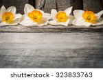 Spring Flowers On Wooden...