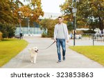 Stock photo family pet domestic animal season and people concept happy man with labrador retriever dog 323853863
