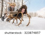 two boys sledding with mountain ... | Shutterstock . vector #323874857