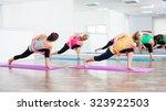 four girls practicing yoga | Shutterstock . vector #323922503