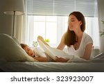 portrait of young mother... | Shutterstock . vector #323923007