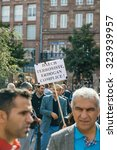 Small photo of STRASBOURG, FRANCE - OCT 4, 2015 Demonstrators protesting against Turkish President Recep Tayyip Erdogan's visit to Strasbourg - Daesh terrorist and Erdogan is an accomplice