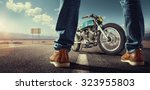 sport. biker standing near the... | Shutterstock . vector #323955803