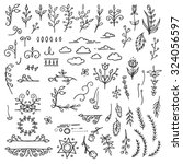 set of hand drawn black doodle... | Shutterstock .eps vector #324056597