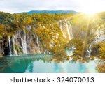 waterfall in autumn mountain... | Shutterstock . vector #324070013