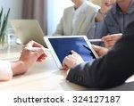 business adviser analyzing... | Shutterstock . vector #324127187