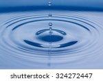 water drop falling into water... | Shutterstock . vector #324272447