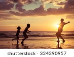 father and children playing on... | Shutterstock . vector #324290957
