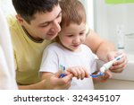 child boy and his dad brushing...   Shutterstock . vector #324345107