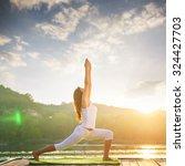 woman doing yoga on the lake  ... | Shutterstock . vector #324427703
