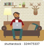 young man freelancer working... | Shutterstock .eps vector #324475337