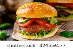 vegetarian burger with grilled... | Shutterstock . vector #324556577