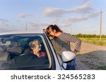 two women chatting on a rural... | Shutterstock . vector #324565283
