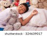 a little asian boy sleep with... | Shutterstock . vector #324639017