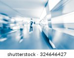motion blurred crowded people... | Shutterstock . vector #324646427