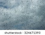 rain drop on car window in bad... | Shutterstock . vector #324671393