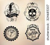set vector tattoo studio logo... | Shutterstock .eps vector #324685337