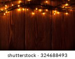 christmas lights on wooden... | Shutterstock . vector #324688493