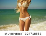 beautiful slender blonde at the ... | Shutterstock . vector #324718553
