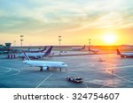 Small photo of Airport with many airplanes at beautiful sunset